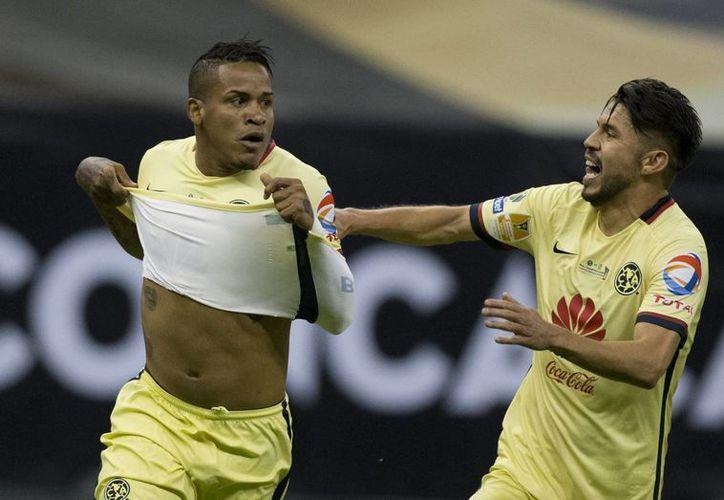 'Micky' Arroyo celebra el gol que abrió la puerta del bicampeonato de la Concachampions a las Águilas del América. (AP)