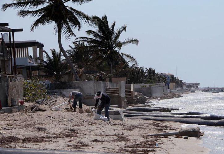Autoridades federales suspendieron temporalmente la construcción de dos viviendas. (Milenio Novedades)