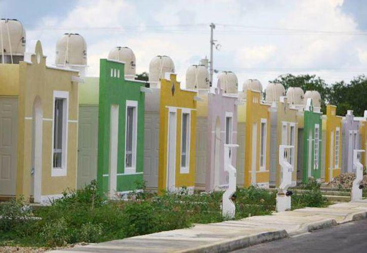 Crimen organizado presiona a derechohabientes de Infonavit y Fovissste que tienen rezagos en sus pagos para vender sus viviendas. (Milenio Novedades)