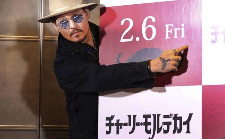 Johnny Depp promueve en Japón su más reciente película 'Mortdecai'. (Foto: AP)