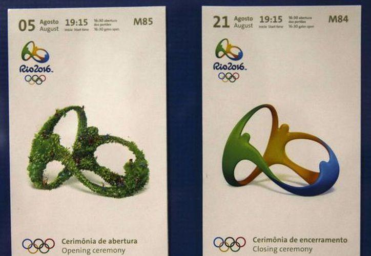 Para quienes ya consiguieron sus entradas para asistir a los Juegos Olímpicos las autoridades recomiendan no colocar en internet dichos documentos para evitar su plagio. (EFE)