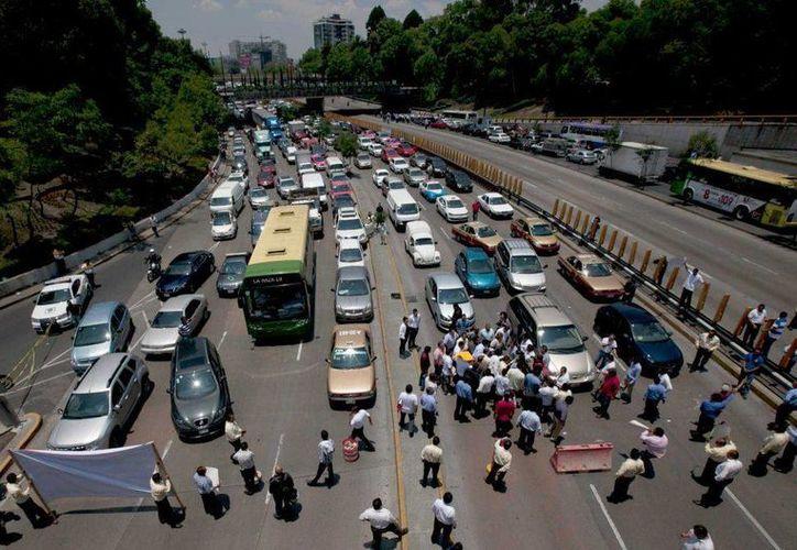 La presencia de Uber en la Ciudad de México generó tal molestia de los taxistas, que para presionar al Gobierno decidieron bloquear calles y avenidas. (Archivo/AP)
