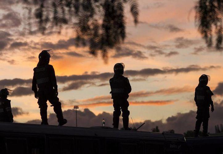 Imagen de contexto. Autoridades y Familiares despidieron a los policías que fallecieron durante el ataque de un grupo armado, en Tlaquepaque, Jalisco. (Notimex/archivo)