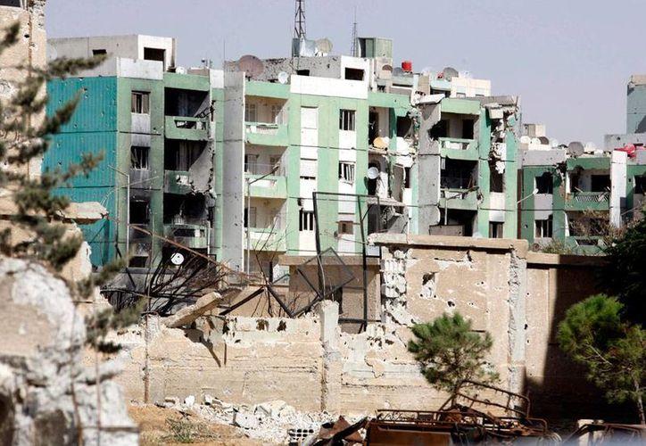 El régimen sirio bombardeó Duma, principal bastión de los rebeldes. En el ataque murieron 15 personas, según el Observatorio de Derechos Humanos. La imagen no es del hecho, es sólo de contexto y corresponde a la ciudad de Adra. (Archivo/Efe)