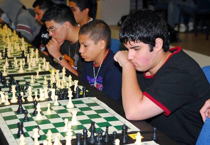 En el torneo de ajedrez  Francisco Yam Can de este domingo participarán menores de muy diversas categorías. (Milenio Novedades)