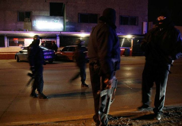 Hace ya casi un año, más de 10 jóvenes fueron secuestrados en un bar de la Ciudad de México. Los cadáveres de algunos de ellos 'aparecieron' en el Estado de México. Foto de la zona en donde ocurrió el plagio, en DF. (Archivo/Efe)