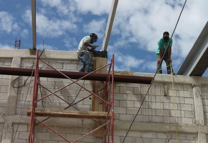 Las empresas constructoras de Yucatán  dejaron de generar 105 millones de pesos, según cifras del Inegi. (Milenio Novedades)