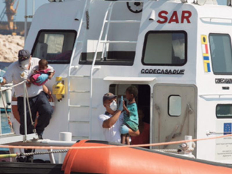 Children disembark from an Italian Coast Guard ship in the port of Pozzallo, Southern Italy.