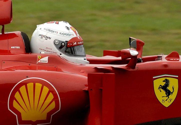 Vettel sustituirá a Alonso la próxima temporada. (Foto: AP)