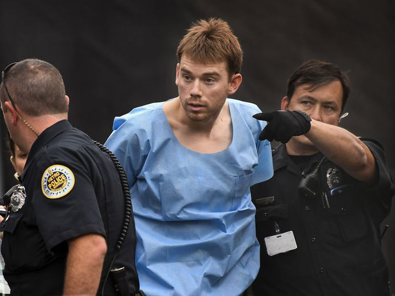 Travis Reinking, suspected of killing four people in a late-night shooting at a Waffle House restaurant, is escorted into the Hill Detention Center in Nashville, Tenn.
