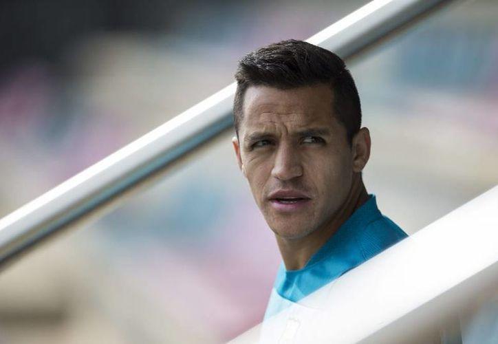 Como el Arsenal hizo la mejor oferta por el chileno, Alexis Sánchez vestirá la camiseta de los 'gunners'. (EFE/Archivo)