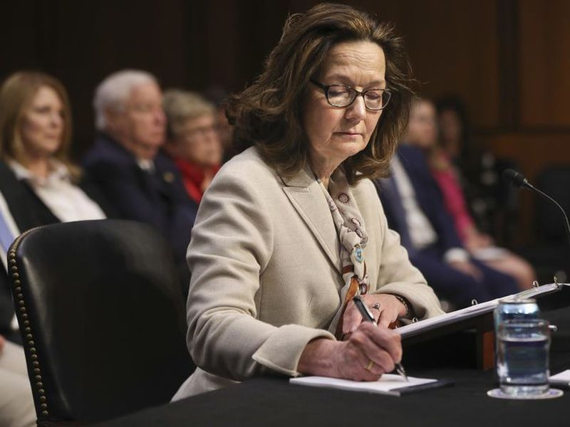 CIAnominee Gina Haspel writes in a note pad.