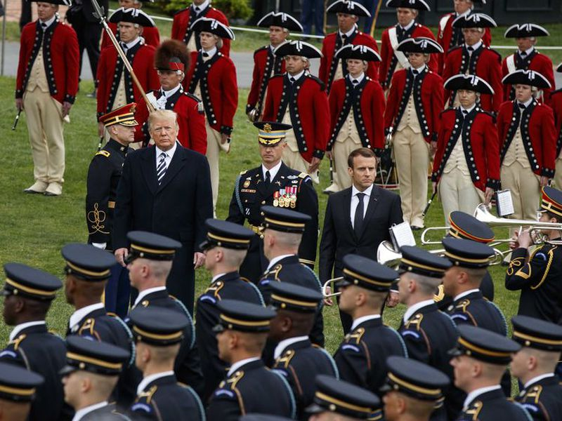 President Donald Trump and French President Emmanuel Macron participate in a State Arrival Ceremony on the South Lawn of the White House, in Washington. (Ap)