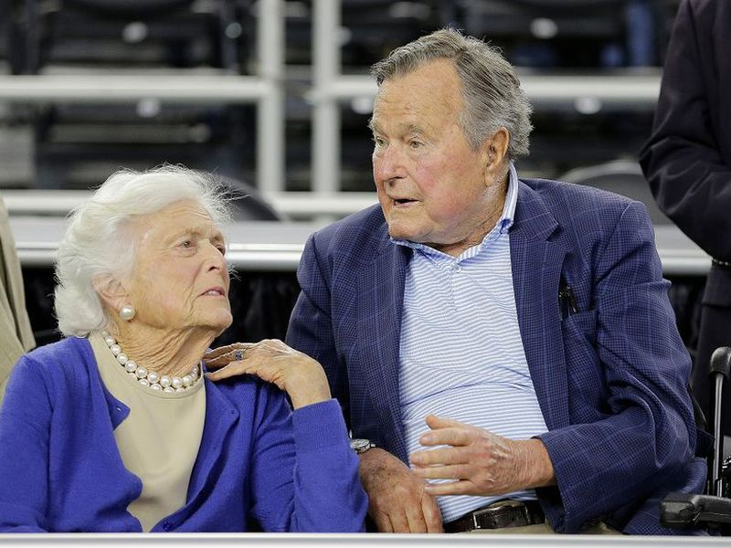 In this March 29, 2015, file photo, former President George H.W. Bush and his wife Barbara Bush, left, speak before a college basketball regional final game between Gonzaga and Duke, in the NCAA basketball tournament in Houston. A family spokesman said.