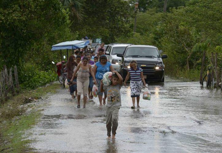 Las afectaciones por las lluvias e inundaciones ocurridas entre el 23 y 24 de diciembre obligaron a declarar como zona de desastre Centla, Centro y Teapa en Tabasco. (Notimex)