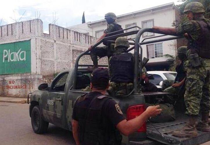 El Ejército mexicano controla , desde abril, la seguridad en Luvianos, donde ayer se enfrentaron a presuntos delincuentes, con saldo de 4 civiles muertos. (Archivo/excelsior.com.mx)