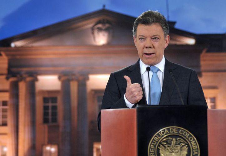 Santos encargó un estudio sobre las repercusiones de separarse de la jurisdicción de La Haya. (Archivo/Notimex)