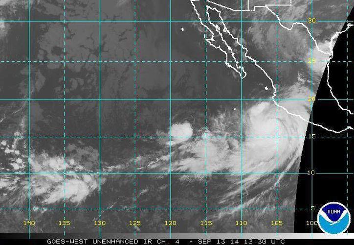 El huracán Odile, que ya es categoría I, generará lluvias intensas en regiones montañosas de Guerrero, Michoacán, Colima, Jalisco y Nayarit. (ssd.noaa.gov)