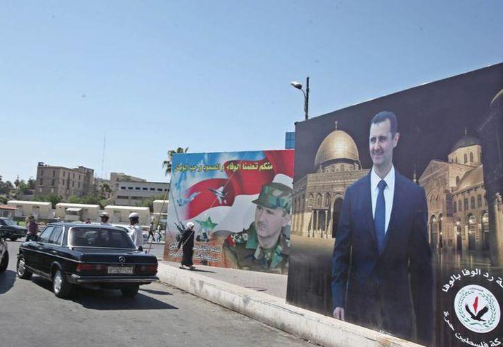Al Asad tiene amplio respaldo entre los habitantes de Damasco, donde sus habitantes no han sufrido los embates de la guerra civil. (EFE)