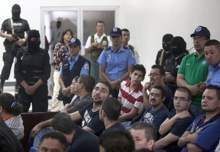 El juez noveno de distrito de lo penal, Edgard Altamirano, impuso penas de 35 y 34 años de prisión para los reos. (Agencias)