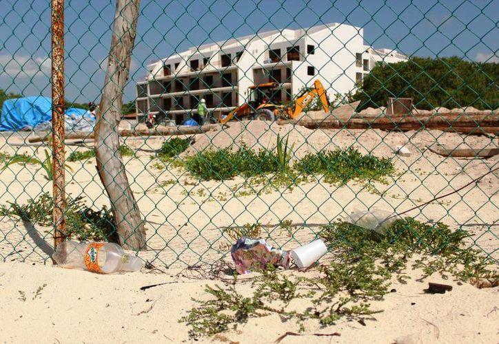Según el manifiesto de impacto ambiental se dice que edifican alrededor de mil cuartos de hospedaje para turismo. (Octavio Martínez/SIPSE)