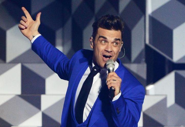 Robbie asegura que volverá a los escenarios tras retirarse por problemas de salud. (Foto: Alexis)