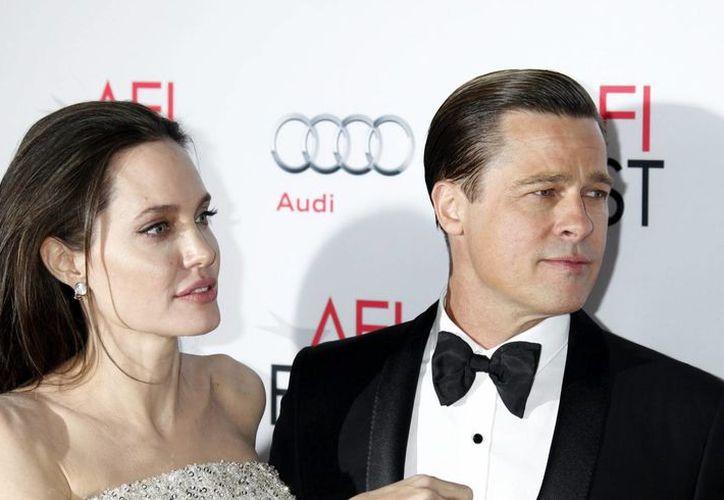 Angelina Jolie pidió el 19 de septiembre el divorcio a Pitt y solicitó la custodia legal de los seis hijos que tienen:tres de ellos adoptados.(EFE)
