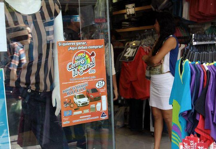 Más de 1,000 comercios participan en la promoción del sorteo Ven al Centro y Gana que busca mover las ventas en el Centro Histórico de Mérida. (Milenio Novedades)