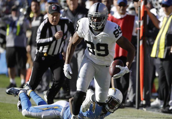 Con la victoria ante San Diego, los Raiders de Oakland pusieron sus números en 11 victorias y tres derrotas.(Alex Gallardo/AP)