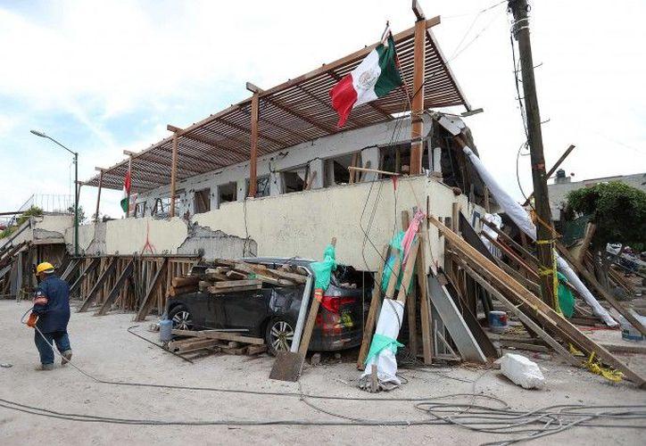 Al edificio no ha ingresado maquinaria aun cuando ya transcurrieron 72 horas establecidas en el protocolo. (Foto: Notimex)