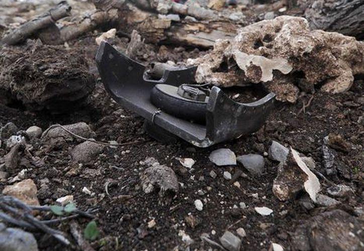 El avión de Jenni Rivera chocó a casi 2 km. de donde comenzó a desplomarse. (EFE)