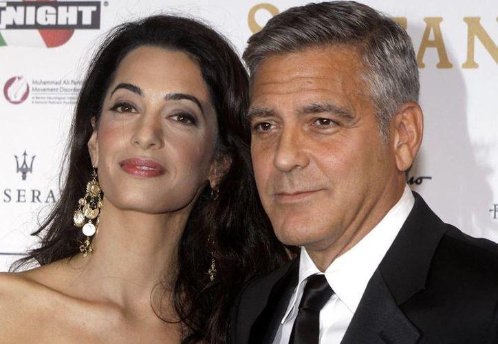 George Clooney reveló el lugar de su boda con Amal Alamuddin durante una gala benéfica el domingo en Florencia. (AP)