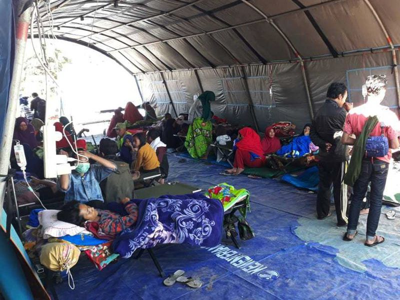 Earthquake survivors receive medical treatment at a temporary shelter in Sembalun, East Lombok, Indonesia. (AP)