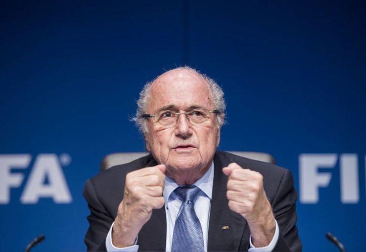 Blatter podría usar el éxito económico del último cuatrienio como plataforma para ganar la elección de la Fifa. (Foto: AP)