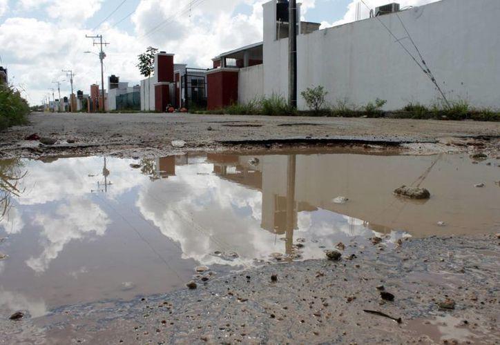 Las ciudades con mayores problemas de calles dañadas son Chetumal y Cancún. (Francisco Sansores/SIPSE)