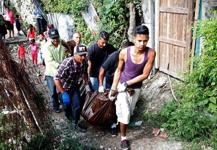 Desconocidos mataron a balazos a varios hombres de la misma familia, en Honduras. (AP)