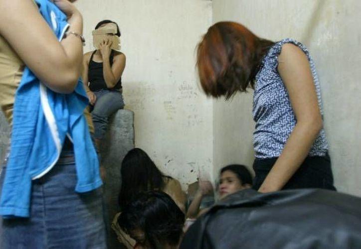 13 individuos fueron detenidos por tráfico sexual y red de prostitución, explotaban a docenas de mujeres. (Archivo SIPSE)