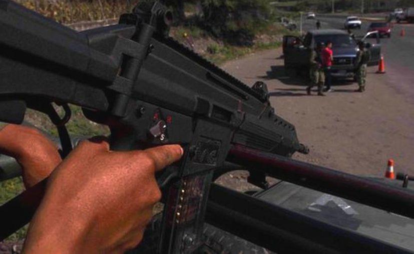 Fuentes de la Policía federal confirmaron que grupos de autodefensa ingresaron en la comunidad denominada El Ceñidor, en el municipio de Parácuaro. (Daniel Cruz/MILENIO)