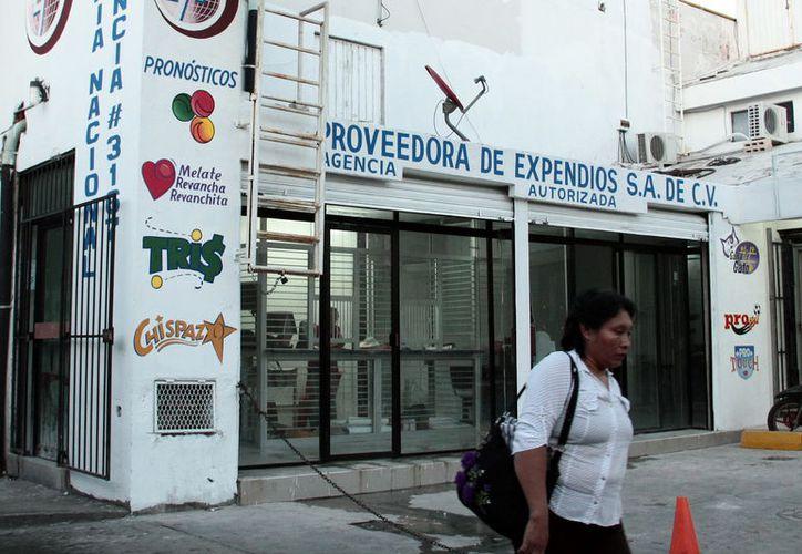 Yucatecos gastan cada vez menos dinero en comprar boletos de lotería; sin embargo, la suerte le sonríe cada vez más. (Archivo/SIPSE)