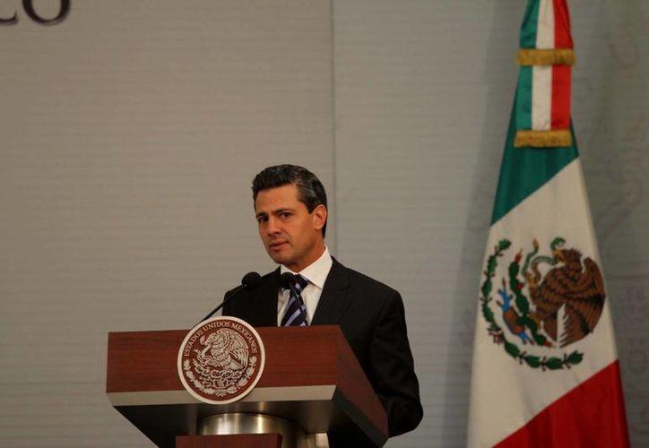 Peña Nieto señaló que esa industria representa el nueve por ciento del Producto Interno Bruto. (Archivo/Notimex)
