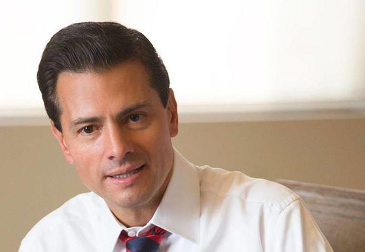 El presidente garantizó que Miguel Ángel Osorio Chong y Aurelio Nuño permanecerán en sus cargos para ocuparse de la negociación con la CNTE. (facebook.com/EnriquePN)