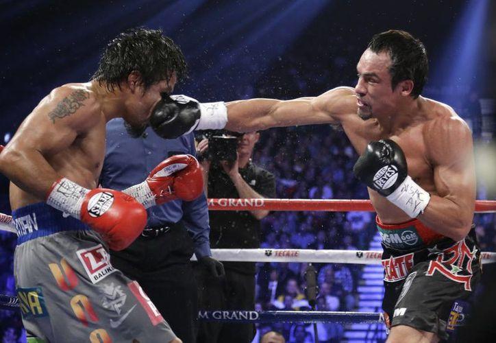 A pesar de las secuelas que le dejó la derrota ante Marquez, Paquiao no piensa en el retiro. (Foto: Agencias)