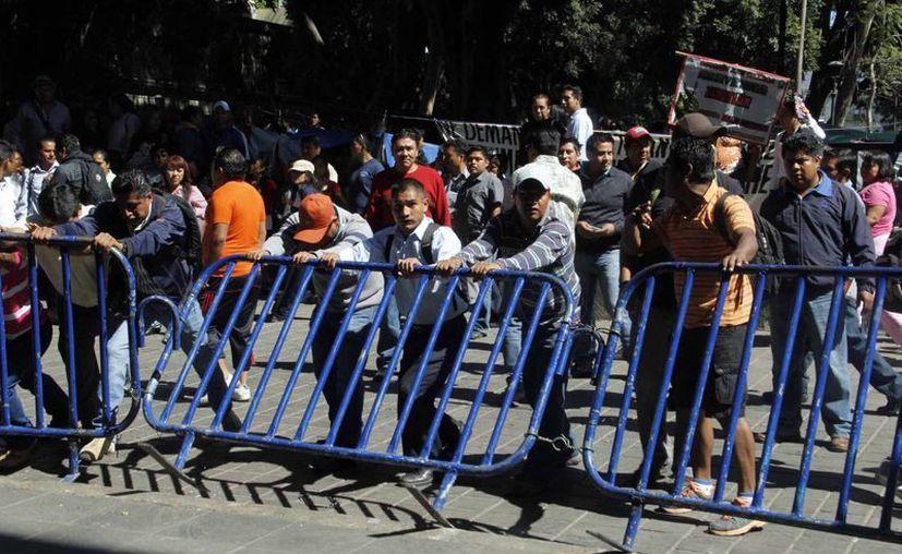 Maestros de la Sección 22 del SNTE en Oaxaca durante una marcha en contra de la reforma educativa. (Notimex)