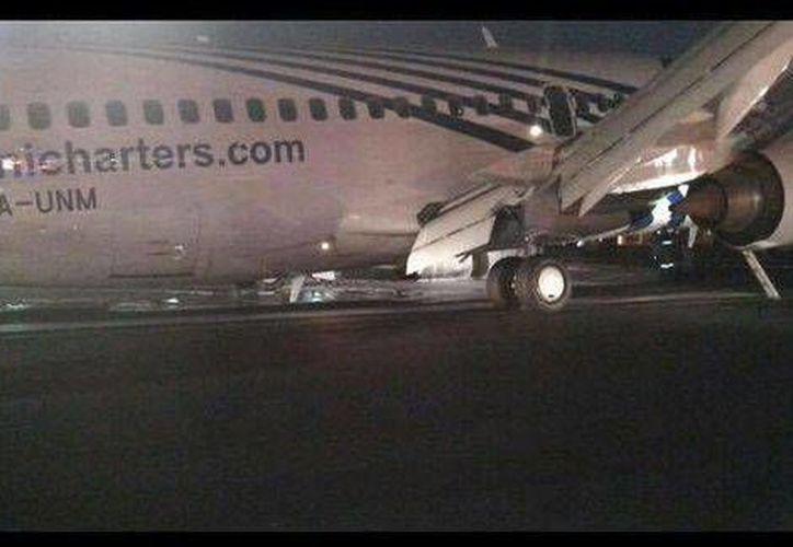 El avión accidentado pertenece a la aerolínea Magnicharters y procedía de la ciudad de Cancún, Quintana Roo. (Twitter @Enel_Aire)