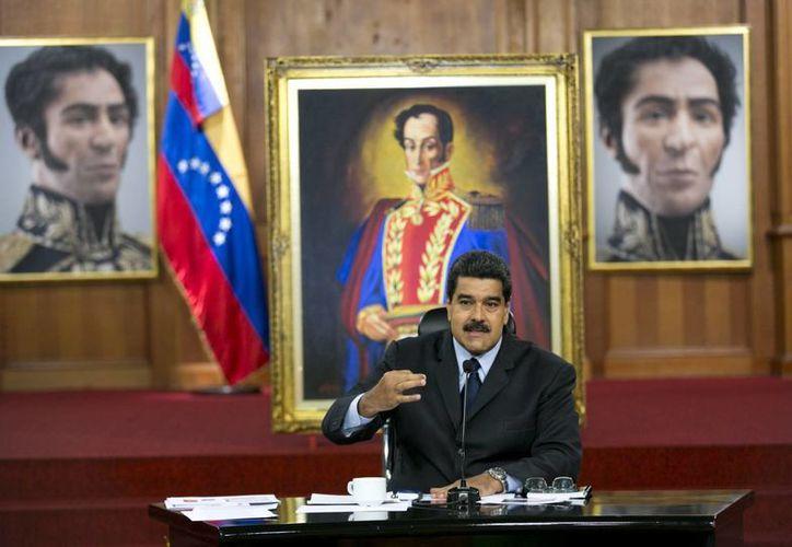 Nicolás Maduro espera que la oposición pida perdón por los muertos en las revueltas de 2014 en Caracas. (AP/Ariana Cubillos)