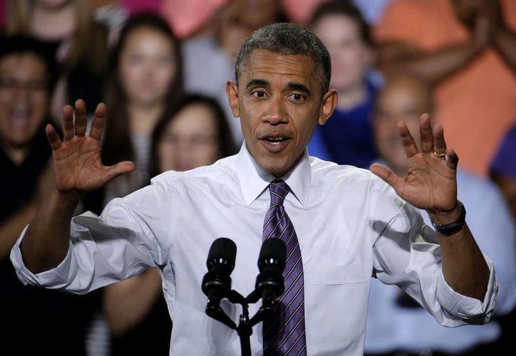El presidente de EU, Barack Obama, habla sobre la economía el miércoles 30 de julio del 2014 en Kansas City, Missouri. (Foto AP/Charlie Riedel)