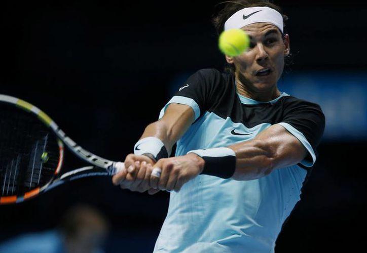 Rafael Nadal ganó a David Ferrer en el Masters de Londres. El tenista español ya estaba calificado a semifinales, pero no Stan Wawrinka, que hoy lo logró al vencer a Andy Murray. (AP)
