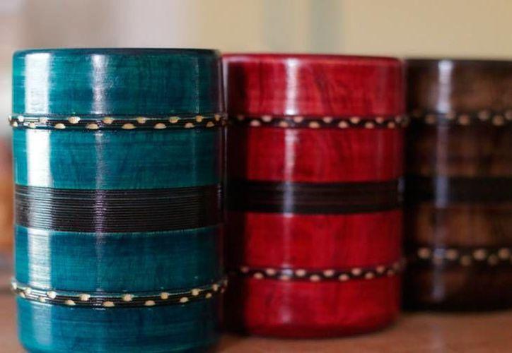 Los talladores de madera de Dzityá ya tiene una nueva forma de difundir sus productos: por medio de una página web. (Facebook)