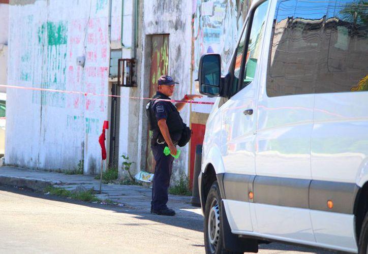 El lugar continúa con el resguardo de elementos policíacos. (Daniel Pacheco/SIPSE)