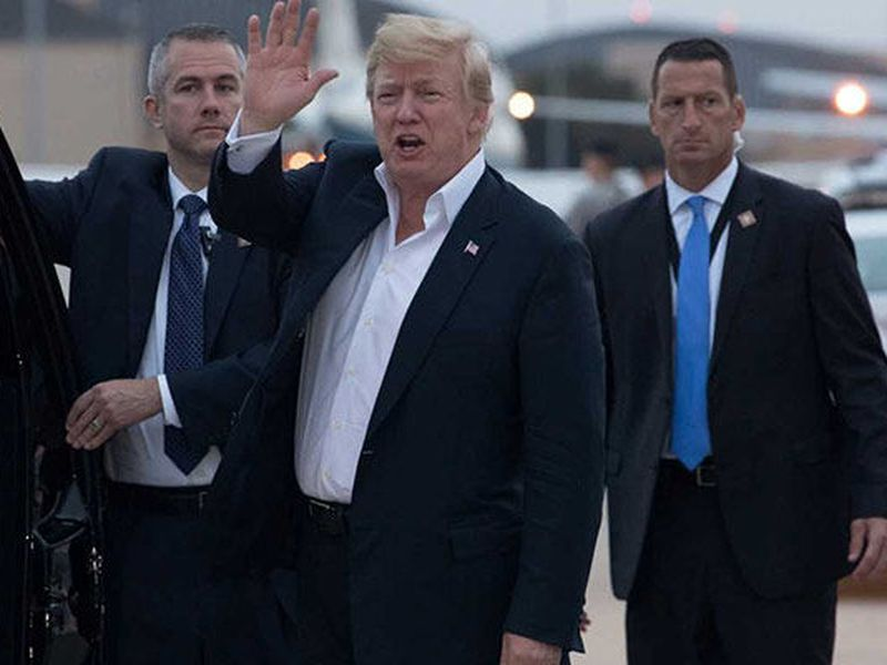 U.S. President Donald Trump yells to reporters after arriving at Andrews Air Force Base after a summit with North Korean leader Kim Jong Un. (Photo: AP)